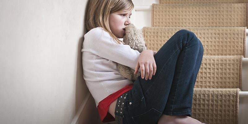 Funding halved on services for vulnerable children across England